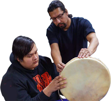 Youth learning to make a drum